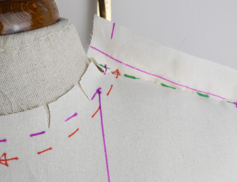 neckline-pinned-on-front-shoulder-ad